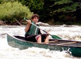 Learn how to navigate a canoe down a river in Whitewater Canoeing